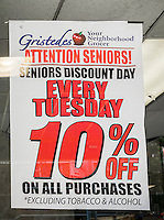 A sign at the entrance of a John Catsimatidis' Gristede's supermarket on Monday, June 29, 2015 reminds seniors of their senior citizen 10 percent discount on Tuesdays. (©Richard B. Levine)