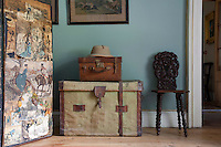 Antique trunks and a Victorian decoupage screen furnish the entrance hall at Lisnavagh House