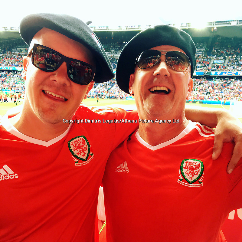 COPY BY TOM BEDFORD MEDIA<br /> Pictured: Matt Evans (L) with his dad Chris in France to watch Wales play against Northern Ireland<br /> Re: Former postman, lotto Millionaire Matt Evans, 35, from Barry, south Wales, has been spending his winnings to watch Wales play in the UEFA European Championship in France.