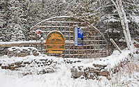 The entrance to the Clearing Visitor Center sits dusted with a fresh coating of snow on a winter's morning, Ellison Bay, Door County, Wisconsin.