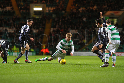 02.03.2016. Celtic Park, Glasgow, Scotland. Scottish Premier League. Celtic versus Dundee. Stuart Armstrong is brought down by Paul McGinn