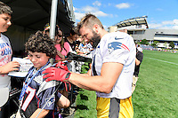 Wednesday, August 17, 2016: New England Patriots wide receiver Julian Edelman (11) signs the shirt of a fan at a joint training camp session between the Chicago Bears and the New England Patriots held at Gillette Stadium in Foxborough Massachusetts. Eric Canha/CSM