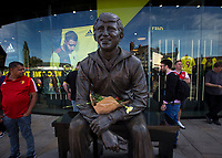 Flowers on the statue of former manager Graham Taylor outside the stadium on what would have been his 75th birthday during the Premier League match between Watford and Arsenal at Vicarage Road, Watford, England on 16 September 2019. Photo by Andy Rowland.