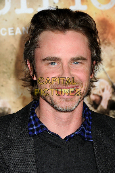 "SAM TRAMMELL.HBO's ""The Pacific"" Mini-Series Premiere held at Grauman's Chinese Theatre, Hollywood, California, USA..February 24th, 2010.headshot portrait black stubble facial hair grey gray  blue collar check plaid .CAP/ADM/BP.©Byron Purvis/AdMedia/Capital Pictures."