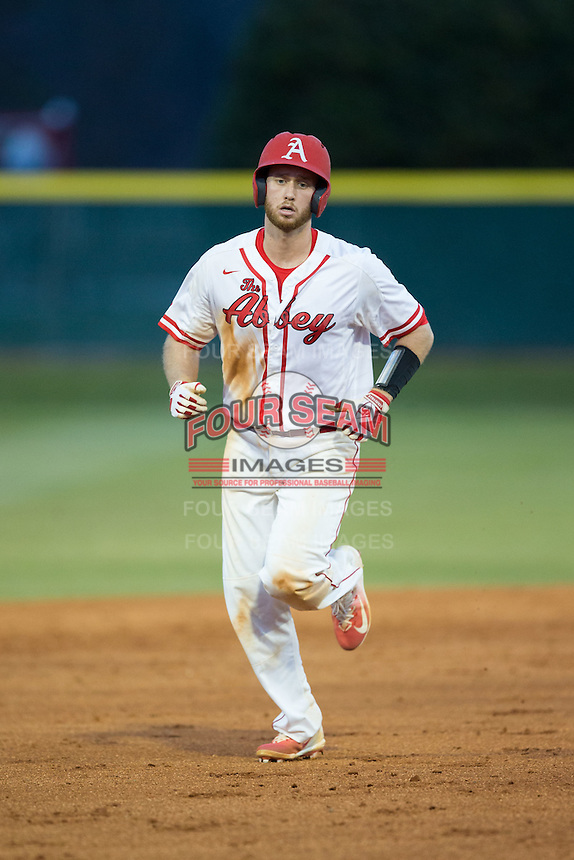 Thomas Yoder (20) of the Belmont Abbey Crusaders rounds the bases after hitting a 3-run home run against the Catawba Indians at Abbey Yard on February 7, 2017 in Belmont, North Carolina.  The Crusaders defeated the Indians 12-9.  (Brian Westerholt/Four Seam Images)