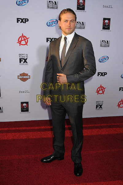 Charlie Hunnam<br /> &quot;Sons of Anarchy&quot; Season Six Premiere Screening held at the Dolby Theatre, Hollywood, California, USA, 7th September 2013.<br /> full length beard facial hair white shirt grey gray suit <br /> CAP/ADM/BP<br /> &copy;Byron Purvis/AdMedia/Capital Pictures