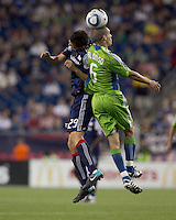 New England Revolution midfielder Marko Perovic (29) and Seattle Sounders FC midfielder Osvaldo Alonso (6) battle for head ball. The New England Revolution defeated the Seattle Sounders FC, 3-1, at Gillette Stadium on September 4, 2010.