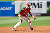 Greensboro Grasshoppers third baseman Matt Juengel (17) on defense against the Delmarva Shorebirds at NewBridge Bank Park on May 26, 2013 in Greensboro, North Carolina.  The Grasshoppers defeated the Shorebirds 11-2.  (Brian Westerholt/Four Seam Images)