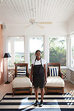 EXUMAS, Bahamas. A staff person in the sitting room at the Hill House, the main common area at the Fowl Cay Resort.