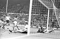 30.07.1966. Wembley Stadium, London England. 1966 World Cup final England versus Germany (4-2) After Extra time.  Englands goal for 2-1 from Scorer Martin Peters England as he turns away in celebration watched by Horst Dieter Hottges  Karl Heinz Schnellinger centre and Goalkeeper Hans Tilkowski
