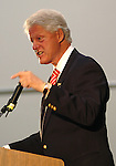 Former President Bill Clinton expresses the need for the U.S. to become less dependant on oil during a rally for his wife, Democratic presidential hopeful Sen. Hillary Rodham Clinton, D-N.Y., Wednesday, May 14, 2008, in Missoula Mont. (AP Photo/James Snook)