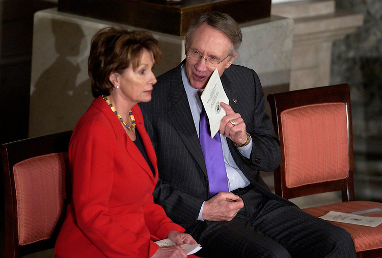 Senate Minority Leader Harry Reid, D-Nev., has a word with House Minority Leader Nancy Pelosi, D-Calif., before the start of an event in Statuary Hall celebrating the 50th anniversary of the Hungarian uprising against Soviet occupation of their country, which helped contribute to global democracy.