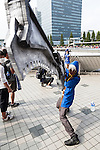 A cosplayer poses for a picture during the ''Comic Market 88 Summer 2015'' exhibition at Tokyo Big Sight on August 14, 2015, Tokyo, Japan. Thousands of manga and anime fans attended the first day of the Comic Market 88 (Comiket) at Tokyo Big Sight. The Comic Market was established in 1975 to allow fans and artists to interact and focuses on manga, anime, gaming and cosplay. The exhibition is held from August 14th to 16th and Comiket organisers expect more than 500,000 visitors to attend. (Photo by Rodrigo Reyes Marin/AFLO)