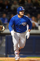 Iowa Cubs first baseman Dan Vogelbach (20) runs to first during a game against the Nashville Sounds on May 3, 2016 at First Tennessee Park in Nashville, Tennessee.  Iowa defeated Nashville 2-1.  (Mike Janes/Four Seam Images)
