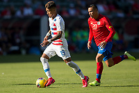 CARSON, CA - FEBRUARY 1: Ulysses Llanez Jr #19 of the United States moves with the ball past David Guzman #20 of Costa Rica during a game between Costa Rica and USMNT at Dignity Health Sports Park on February 1, 2020 in Carson, California.