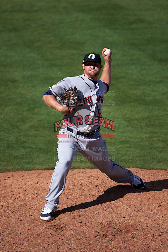 Glendale Desert Dogs pitcher Albert Minnis (52) delivers a pitch during an Arizona Fall League game against the Mesa Solar Sox on October 14, 2015 at Sloan Park in Mesa, Arizona.  Glendale defeated Mesa 7-6.  (Mike Janes/Four Seam Images)