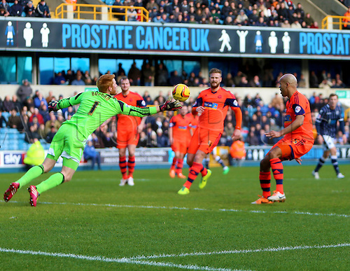 15.02.2014 London, England. A diving save from  goalkeeper Adam BOGDAN  during the Championship game between Millwall and Bolton Wanderers from The New Den.