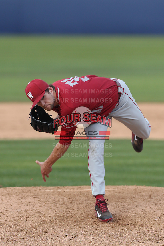 Joe Pistorese #31 of the Washington State Cougars pitches against the Cal State Fullerton Titans at Goodwin Field on  February 15, 2014 in Fullerton, California. Washington State defeated Fullerton, 9-7. (Larry Goren/Four Seam Images)