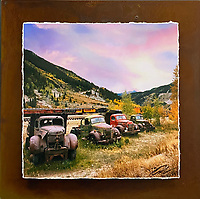 """Trucks of Autumn - Mixed Media - Colorado<br /> <br /> Each unique piece is made to order. If I have the piece in stock I can ship it in 2-3 days. If I don't have it in stock and it has to be made, it will ship in 1-2 weeks. Feel free to contact me at chey.rouse@gmail.com before you order if you need the piece ASAP. <br /> <br /> The photograph is printed on a Silk photo paper, the edges of the photo are torn, photo is mounted to foam board, then I mount it to an 8""""x8"""" piece of rusted metal. The rust is unique on each piece...no two pieces are alike. PLEASE keep in mind that the rust on the piece(s) you receive may be slightly different than the photo. Each piece of metal is sealed after it is done """"rusting"""" and is titled, hand signed and, ready to hang. To see the detail for theses Mixed Media pieces please click on the 1st photo in this gallery. You will be able to see the detail of the torn paper edge as well as the back of the piece."""