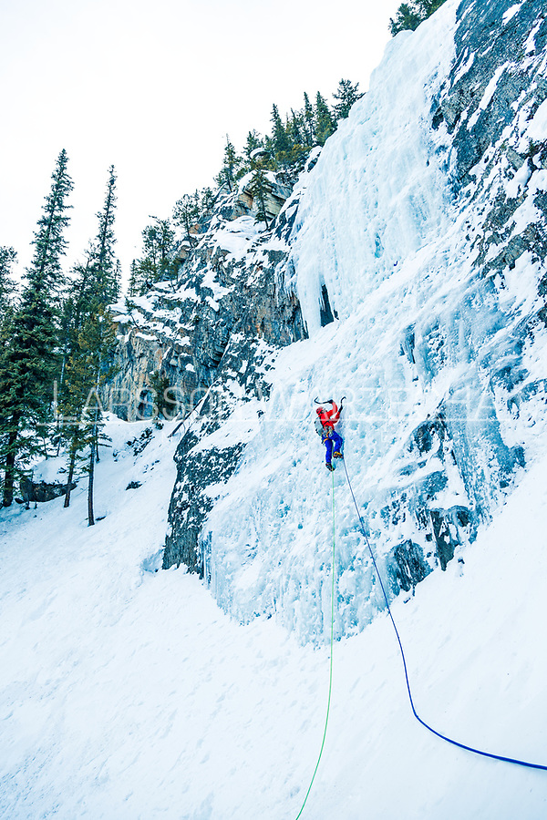 Climber on Guinness Gully,  WI 4 245m is one of the best moderate ice routes in Field. A long climb with an easy approach, the first pitch can take some time to form and is often thin. Second pitch is a 30m grade 4 pillar, the last pitch is nice and long at 50m