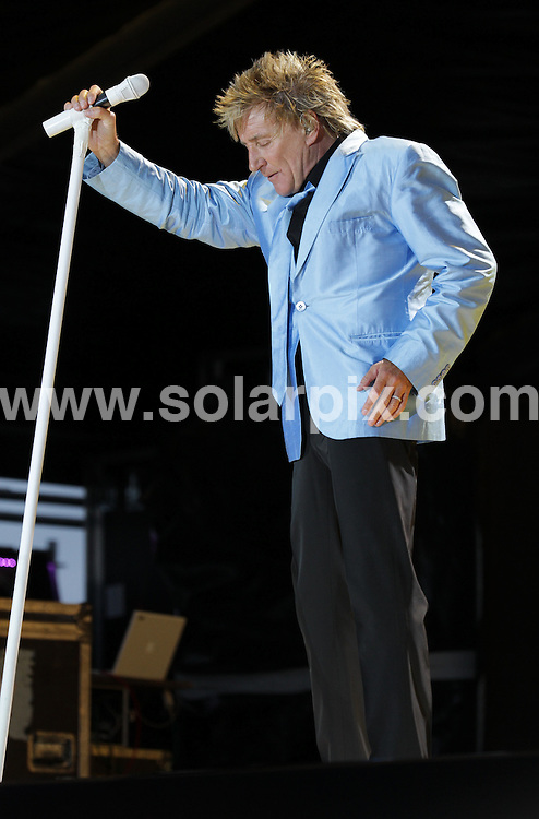 **ALL ROUND PICTURES FROM SOLARPIX.COM**                                             **WORLDWIDE SYNDICATION RIGHTS**                                                                                  Caption: Rod Stewart performs at Newbury Racecourse - part of Newbury Live - to a packed out crowd of 20,000 plus. Stewart performed his hit songs   and changed 3 times into different coloured suits. He also showed his new baby boy Aiden to the thrilled crowd via the large screens on stage. Newbury Racecourse, UK. 29 May 2011                                                                              This pic: Rod Stewart                                                                                             JOB REF: 13460 WMB       DATE: 29_05_2011                                                           **MUST CREDIT SOLARPIX.COM OR DOUBLE FEE WILL BE CHARGED**                                                                      **MUST AGREE FEE BEFORE ONLINE USAGE**                               **CALL US ON: +34 952 811 768 or LOW RATE FROM UK 0844 617 7637**