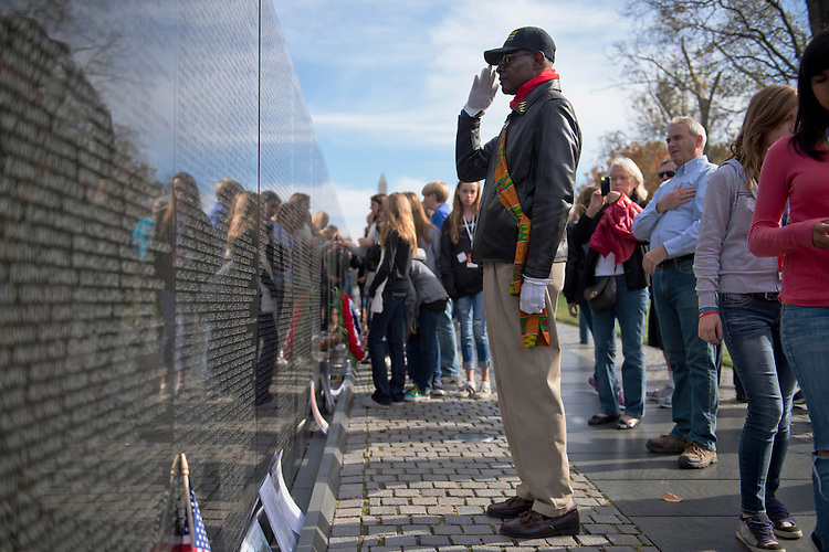 UNITED STATES - NOVEMBER 12:  A Vietnam veteran who declined to be identified, salutes names of the fallen at the Vietnam Veterans Memorial on the Monday, the day the federal government observed the holiday.  Sunday November 11, was the actual date of the holiday.  (Photo By Tom Williams/CQ Roll Call)