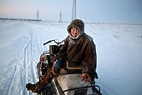 Reindeer herder Simyon sits on his snowmobile after a journey of several hours to reach a shop in the town of Sovetsky. /Felix Features