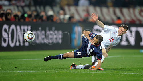 Steve Cherundolo of USA fights for the ball with James Milner of England in action during a FIFA World Cup 2010 football match between England and USA at the Royal Bafokeng Stadium, on June 12, 2010 in Rustenburg, South Africa.
