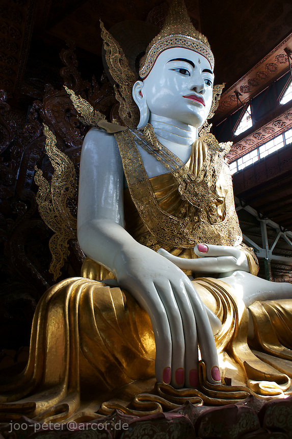 monumental sculpture of  sitting Buddha in Ngahtatgyi Paya temple, Yangon, Myanmar, 2011