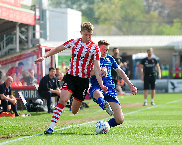 Lincoln City's Mark O'Hara vies for possession with Tranmere Rovers' Paul Mullin<br /> <br /> Photographer Andrew Vaughan/CameraSport<br /> <br /> The EFL Sky Bet League Two - Lincoln City v Tranmere Rovers - Monday 22nd April 2019 - Sincil Bank - Lincoln<br /> <br /> World Copyright © 2019 CameraSport. All rights reserved. 43 Linden Ave. Countesthorpe. Leicester. England. LE8 5PG - Tel: +44 (0) 116 277 4147 - admin@camerasport.com - www.camerasport.com