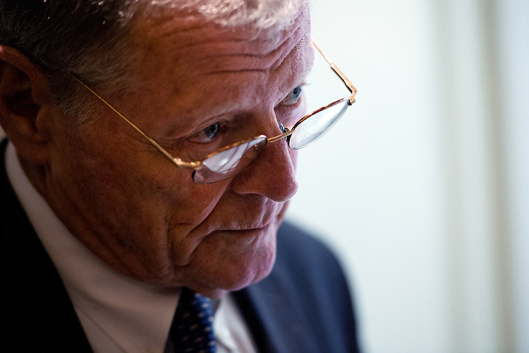 UNITED STATES - JULY 21: Sen. James Inhofe, R-Okla., talks with reporters before the Senate Policy luncheons in the Capitol, July 21, 2015. (Photo By Tom Williams/CQ Roll Call)