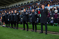 Graham Potter Manager of Swansea City takes part in a minutes appluads for Gordon Banks during the FA Cup Fifth Round match between Swansea City and Brentford at the Liberty Stadium in Swansea, Wales, UK. Sunday 17 February 2019