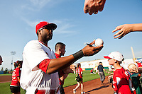 Xavier Scruggs (15) of the Springfield Cardinals signs autographs for fans prior to a game against the Arkansas Travelers at Hammons Field on May 5, 2012 in Springfield, Missouri. (David Welker/Four Seam Images)