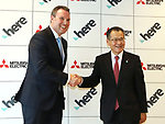 October 27, 2017, Tokyo, Japan - Dutch open location platform company HERE Technologies president Edzard Overbeek (L) shakes hands with Japan's Mitsubishi Electric senior vice president Isao Iguchi as they announced to collaborate their technologies for autonomous driving technologies in Tokyo on Friday, October 27, 2017. World's largest positioning service company HERE will use Mitsubishi's high definition location technology with quasi-zenith satellite system.   (Photo by Yoshio Tsunoda/AFLO) LWX -ytd-