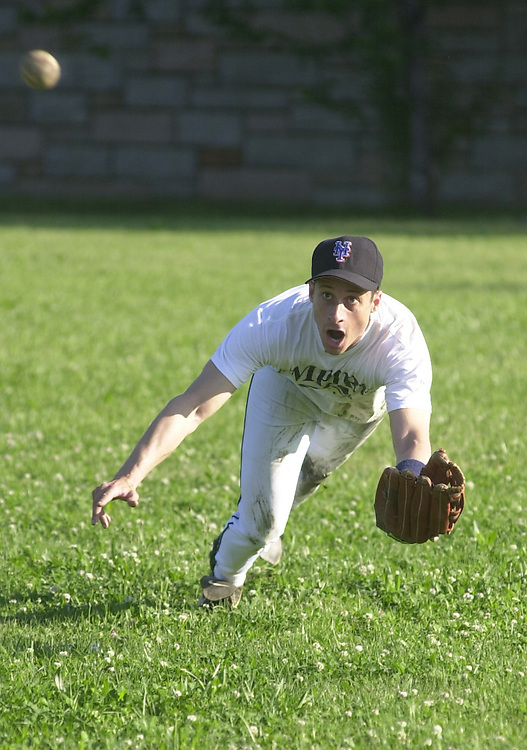 01baseball052301 -- Rep. Anthony Weiner, D-NY, dives for a fly ball at the Democrat's baseball pratice, Wednesday morning.