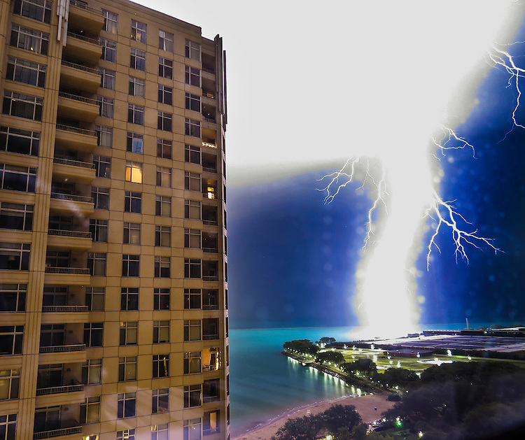 A massive lightning bolt strikes the breakwater just off Navy Pier during a thunderstorm Monday, July, 18, 2016. (DePaul University/Jamie Moncrief)