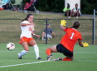 Danielle Colaprico (24) of Virginia passes the ball around Kailen Sheridan (1) of Clemson at Klockner Stadium in Charlottesville, VA.  Virginia defeated Clemson, 3-0.
