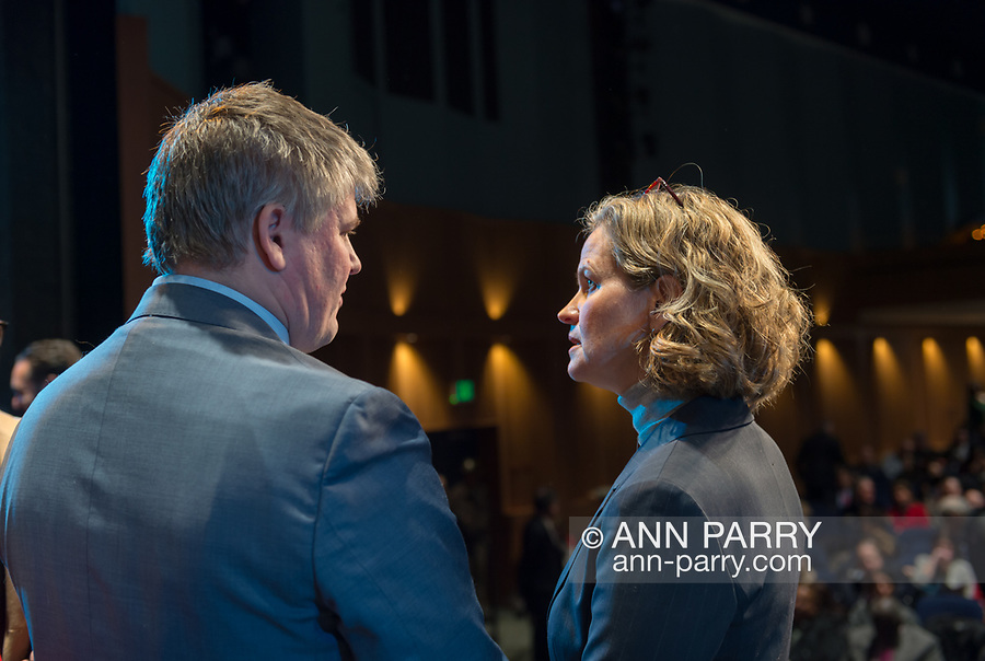 Hempstead, New York, USA. January 1, 2018. L-R, KEITH CORBETT, who is Laura Gillen's transition Counsel, and LAURA CURRAN, the Nassau County Executive-Elect, are talking before start of swearing-In of Laura Gillen as Hempstead Town Supervisor, and Sylvia Cabana as Hempstead Town Clerk, at Hofstra University. Curran was sworn in at Mineola later that day. Keith Corbett is Malverne Village Trustee.