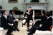 United States President Ronald Reagan makes a point during an interview with television network anchors in the Oval Office of the White House in Washington, D.C. on Thursday, December 3, 1987.  Seated, from left, are: Tom Brokaw of NBC; Bernard Shaw of CNN; President Reagan; Dan Rather of CBS; and Peter Jennings of ABC. .Mandatory Credit: Bill Fitz-Patrick - White House via CNP