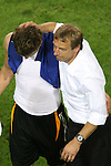 04 July 2006: Head coach Juergen Klinsmann (GER) (right) comforts Sebastian Kehl (GER) (left) after the Germany loss. Italy defeated Germany 2-0 in overtime at Signal Iduna Park, better known as Westfalenstadion, in Dortmund, Germany in match 61, the first semifinal game, in the 2006 FIFA World Cup.