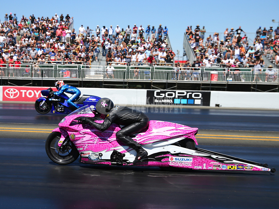 Jul 30, 2017; Sonoma, CA, USA; NHRA pro stock motorcycle rider Jerry Savoie (near) races alongside Matt Smith during the Sonoma Nationals at Sonoma Raceway. Mandatory Credit: Mark J. Rebilas-USA TODAY Sports