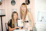 "Nina Garcia poses with fan during Nina Garcia's ""Look Book: What To Wear For Every Occasion"", book release party with Marie Claire at Tous Rockefeller Center, August 17, 2010."