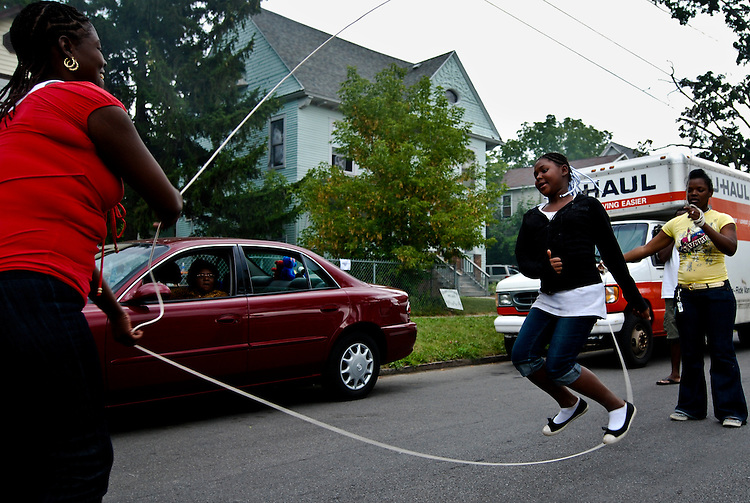 Sharidonah Jones, 10, of Syracuse, N.Y., jumps high into the air during a double dutch game. Many of the local community joined in the fun during the Let's Get It Tour block party on Furman St.      Ben Addonizio (Not For Republication)