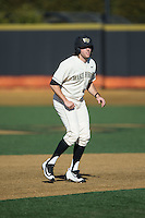 Will Craig (22) of the Wake Forest Demon Deacons takes his lead off of second base against the Richmond Spiders at David F. Couch Ballpark on March 6, 2016 in Winston-Salem, North Carolina.  The Demon Deacons defeated the Spiders 17-4.  (Brian Westerholt/Four Seam Images)