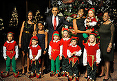 United States President Barack Obama and First Lady Michelle Obama pose for a group photo with children dressed in Christmas elves costumes at a Christmas In Washington celebration at the Building Museum in Washington, DC, USA, Sunday, December 12, 2010.  Obama's daughters Malia and Sasha are at (L) and Michelle Obama's mother Marian Robinson is at (R).     .Credit: Mike Theiler - Pool via CNP