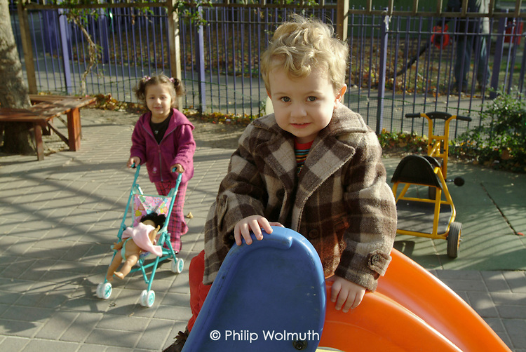 Children playing at the Park View Pre-School Nursery run by the Westminster Pre-School Alliance.  Warwick Estate, North Paddington, West London.