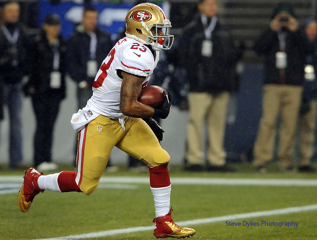 SEATTLE, WA. - DECEMBER 23: Running back LaMichael James #23 of the San Francisco 49ers runs with the ball on a kickoff during the first quarter of the game against the Seattle Seahawks at CenturyLink Field on December 23, 2012 in Seattle,Wa. (Photo by Steve Dykes/Getty Images) *** Local Caption *** LaMichael James