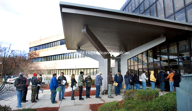 MIDDLETOWN CT. 30 December 2013-123013SV03-Owners of assault weapons and high capacity magazines wait in line to register them at the Department of Emergency Services and Public Protection Special Licensing and Firearms in Middletown Monday. <br /> Steven Valenti Republican-American