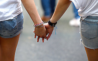 Un momento del Gay Pride a Roma, 7 giugno 2014.<br /> Two girls walk hand in hand during the Gay Pride in Rome, 7 June 2014.<br /> UPDATE IMAGES PRESS/Riccardo De Luca