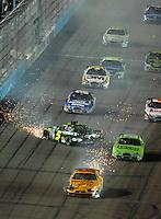 Apr 20, 2007; Avondale, AZ, USA; Nascar Busch Series drivers Ryan Newman (12) and Kyle Busch (5) crash during the Bashas Supermarkets 200 at Phoenix International Raceway. Mandatory Credit: Mark J. Rebilas